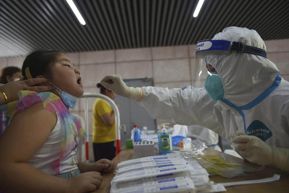 China orders mass testing in Wuhan as COVID outbreak spreads