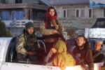 Taliban guard airport as most NATO troops leave Afghanistan